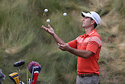 Mathew Goggin juggles four golf ball waiting his turn on the 18th tee during Wednesday's practice round at the U.S. Open at the Merion Golf Club in Ardmore, Pa.