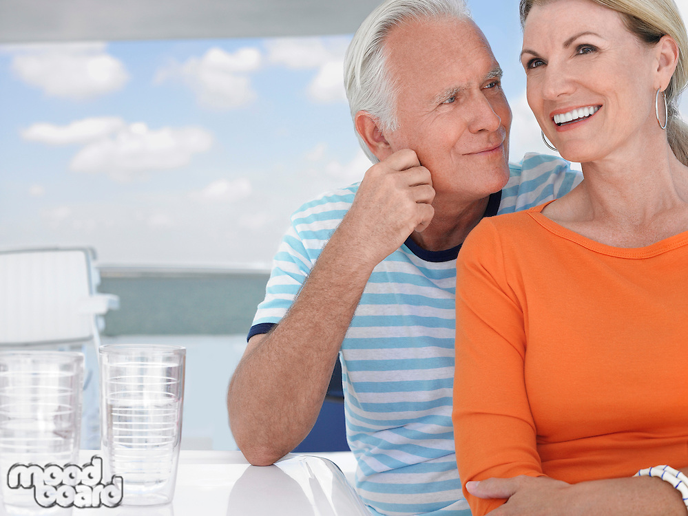 Smiling middle-aged couple outdoors portrait