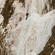 """Róbert Halldórsson (leading) and Sigurður Tómas Þórisson climbing """"Bjarta hlíðin"""" WI6 at Eyjafjöllum, southcoast Iceland."""