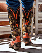 "The boots, spurs, and chaps are functional pieces of equipment used every day by the American cowboy. As well as being functional they can be quite decorative and the spurs are often inlayed with silver or gold.  A pair of decorative boots belonging to Pete ""Stovepipe"" Pette celebrating his long association with Cheyenne Frontier Days."