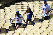 LOS ANGELES, CA - JULY 13:  Fans walk to their seats before the Los Angeles Dodgers game against the San Diego Padres at Dodger Stadium on Sunday, July 13, 2014 in Los Angeles, California. The Dodgers won the game 1-0. (Photo by Paul Spinelli/MLB Photos via Getty Images)