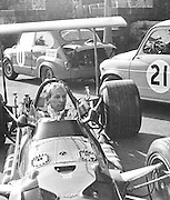 British BRM driver, John Surtees, before training sessions of the 1969 Spanish Grand Prix at the Montjuïc urban circuit in Barcelona, Spain.