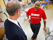 "06 OCTOBER 2010 - PHOENIX, AZ: Terry Goddard (CQ) LEFT talks to Anthony Miller (CQ), who wore a Jan Brewer tee shirt, during a town hall style campaign meeting at Pecos Community Center in the Ahwatukee section of Phoenix. Miller wanted to know why Goddard had not opposed the recently passed health care reform law, which Miller derisively called ""Obamacare.""  Goddard lost the election to sitting Governor Jan Brewer, a conservative Republican.     PHOTO BY JACK KURTZ"