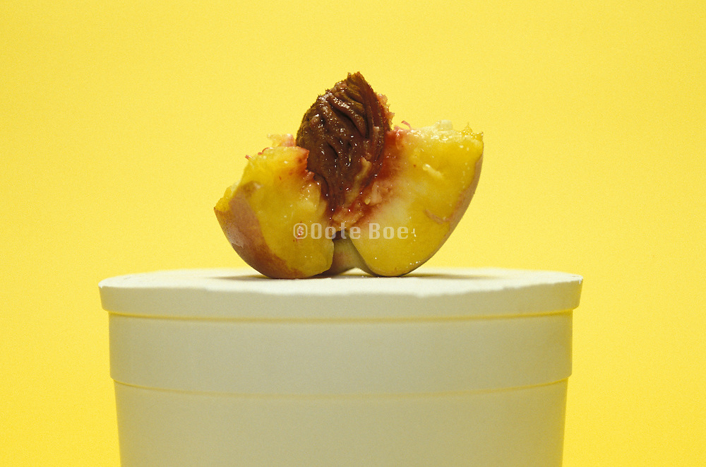 Eaten peach on a pedestal