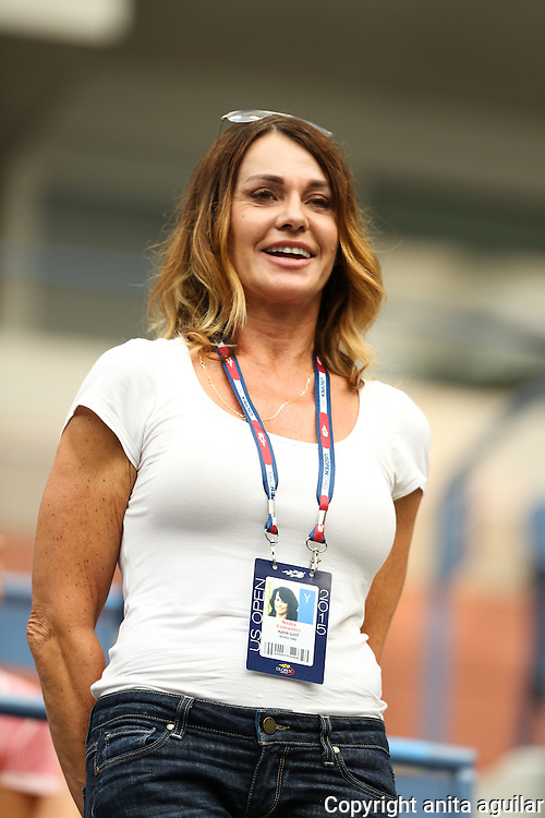 Nadia Comaneci attends the Ladies Quarterfinal Match between Simona Halep and Victoria Azarenka