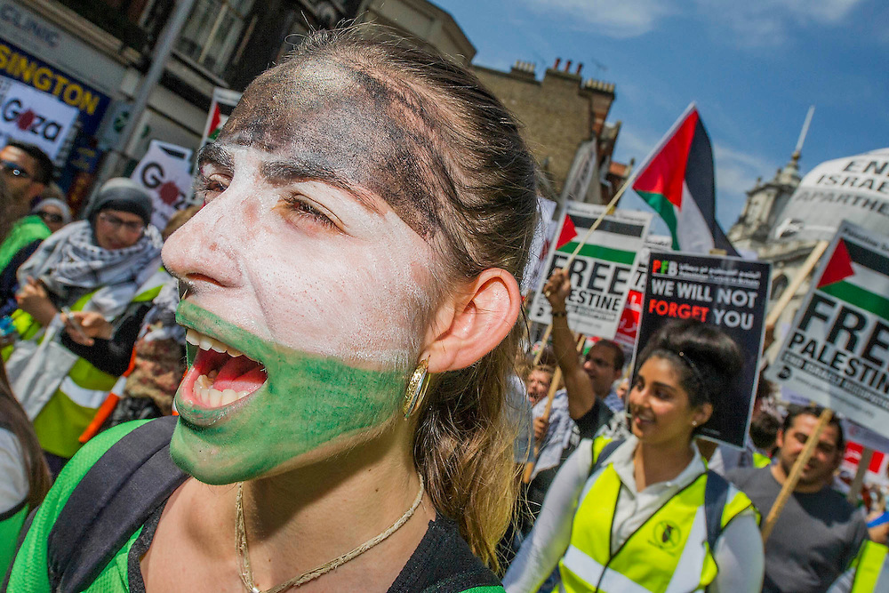 """Stop the 'massacre' in Gaza protest. A demonstration called by: Stop the War Coalition, Palestine Solidarity Campaign, Campaign for Nuclear Disarmament, Friends of Al Aqsa, British Muslim Initiative, Muslim Association of Britain, Palestinian Forum in Britain. They assembled at the Israeli Embassy and marched to Parliament. They called for """"Israel's bombing and killing to stop now and for David Cameron to stop supporting Israeli war crimes"""". London, 26 July 2014. Guy Bell, 07771 786236, guy@gbphotos.com"""