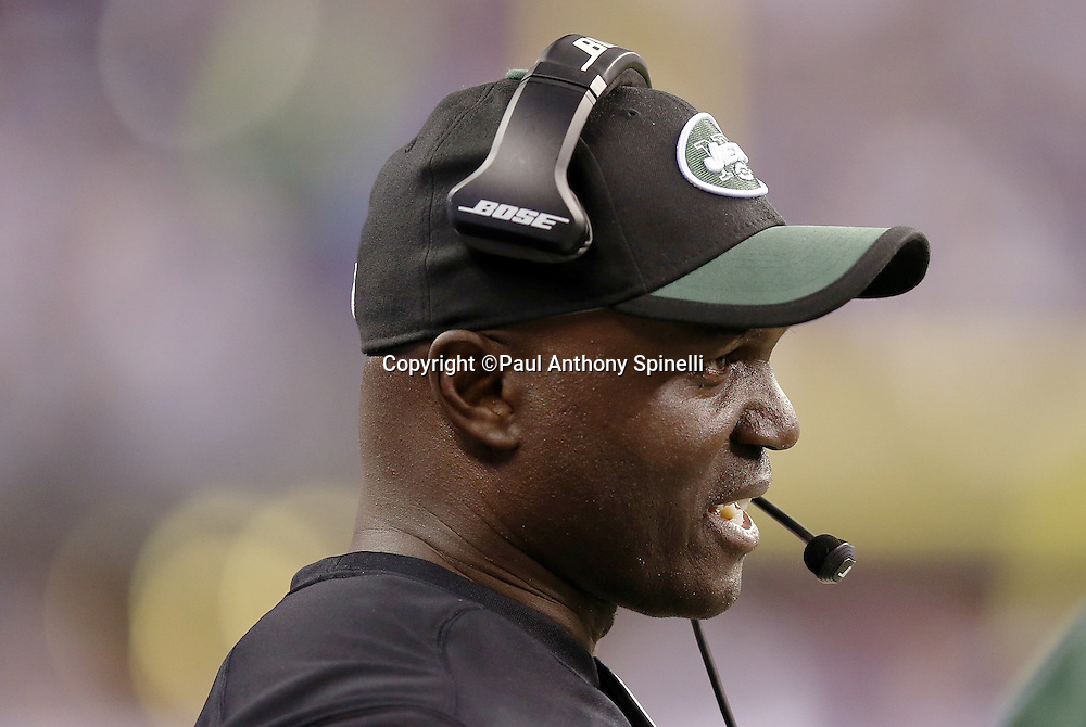 New York Jets head coach Todd Bowles talks on his sideline communication headsets during the 2015 NFL week 2 regular season football game against the Indianapolis Colts on Monday, Sept. 21, 2015 in Indianapolis. The Jets won the game 20-7. (©Paul Anthony Spinelli)