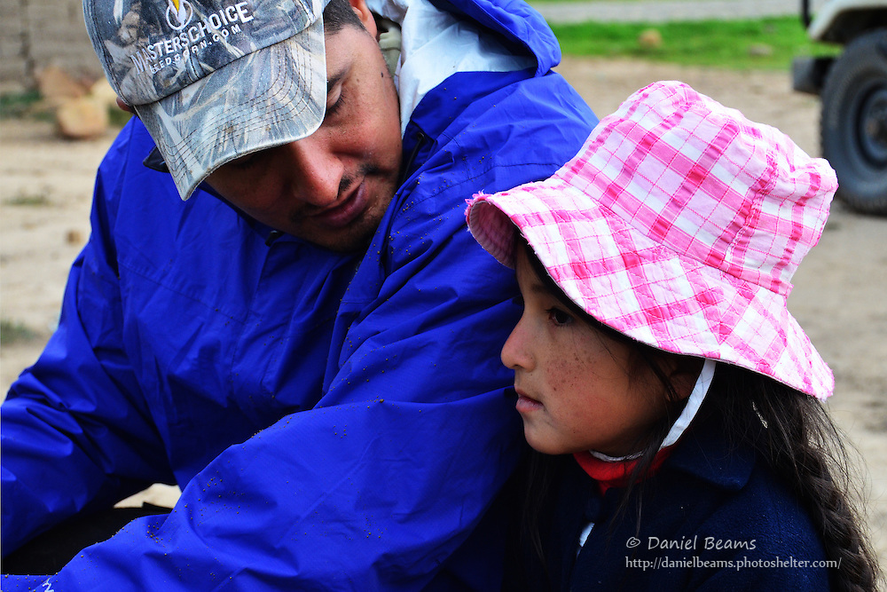 Development worker speaks with Quechua girl, Vacas, Cochabamba, Bolivia