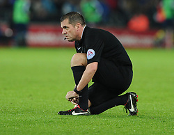 Referee, Phil Dowd  does his laces up  - Photo mandatory by-line: Joe Meredith/JMP - Mobile: 07966 386802 - 09/11/2014 - SPORT - Football - Swanswa - Liberty Stadium - Swansea City v Arsenal - Barclays Premier League