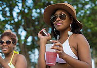 MIAMI - May 26, 2012: Participatnts at the beach during the Miami Beach Urban Weekend, this is the largest Urban Festival in the World, that caters towards the Hip Hop Generation. Over 300.000 participants make the annual trek to South Beach for 4 days full of fun, food, festivities, entertainment, music, and more.