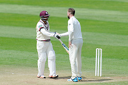 Somerset's Abdur Rehman and New Zealand's Mark Craig shake hands at the end of the match. Photo mandatory by-line: Harry Trump/JMP - Mobile: 07966 386802 - 11/05/15 - SPORT - CRICKET - Somerset v New Zealand - Day 4 - The County Ground, Taunton, England.