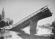 Photograph, 1944, of the Grand-Rue bridge at Sable-sur-Sarthe, Pays de la Loire, France, destroyed in a bombing raid on 7th August by the German Luftwaffe, during the Second World War. The bridge was bombed in order to slow down the advance of the Allies into the town. Picture by Manuel Cohen