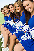 Cheerleading Squad Sitting on Bench