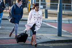 © Licensed to London News Pictures. 04/02/2020. Leeds UK. People make their way to work in the strong winds hitting Leeds city centre this morning. Photo credit: Andrew McCaren/LNP
