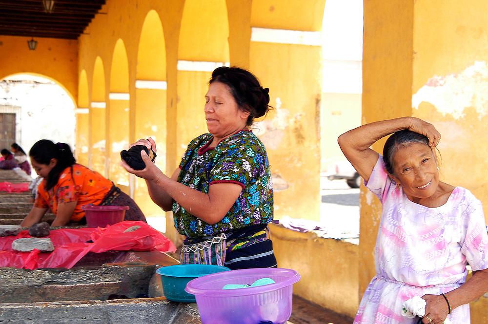 Women wash clothing in Antigua, Guatemala.