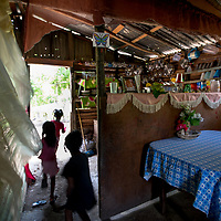 Three children run through their home in the la Cubana area of San Pedro Province in the Dominican Republic, September 12, 2017. The area was not badly hit by Hurricane Irma, though it is prone to diseases, especially now in the rainy season with increased rainfall during the hurricane. Several areas with stagnant water are breeding grounds for mosquitos, increasing cases of dengue, chikungunya, zika and others.