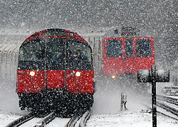 © Licensed to London News Pictures. 18/01/2013. London, UK A Piccadilly Line tube train (front) in the snow. Snow in West London today 18th January 2013. Photo credit : Stephen Simpson/LNP