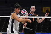 Pepperdine Waves middle blocker Max Chamberlain (13) digs the ball as Princeton Tigers middle blocker Billy Andrew (1) watches during an NCAA Championships opening round match, Wednesday, April 30, 2019, in Long Beach, Calif. Pepperdine defeated Princeton 25-23, 19-25, 25-16, 22-25, 15-8.
