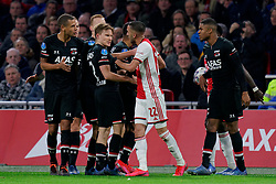 Hakim Ziyech #22 of Ajax and Ramon Leeuwin #27 of AZ Alkmaar, Myron Boadu #9 of AZ Alkmaar during the Dutch Eredivisie match round 25 between Ajax Amsterdam and AZ Alkmaar at the Johan Cruijff Arena on March 01, 2020 in Amsterdam, Netherlands