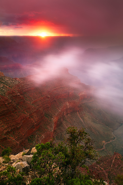 Clouds arise from the depths of Grand Canyon as the sun sets.