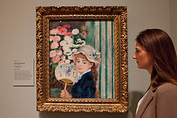 © under license to London News Pictures. 25/06/12. London, UK. A visitor admires the famous paining, Girl with Fan, by Pierre-Auguste Renoir.The exhibition takes place at the Royal Academy of Arts. From Paris: A Taste of Impressionism - paintings from the Clark exhibition. The exhibition showcases seventy major works, many of which have never been on public display in the U.K before...ALEX CHRISTOFIDES/LNP
