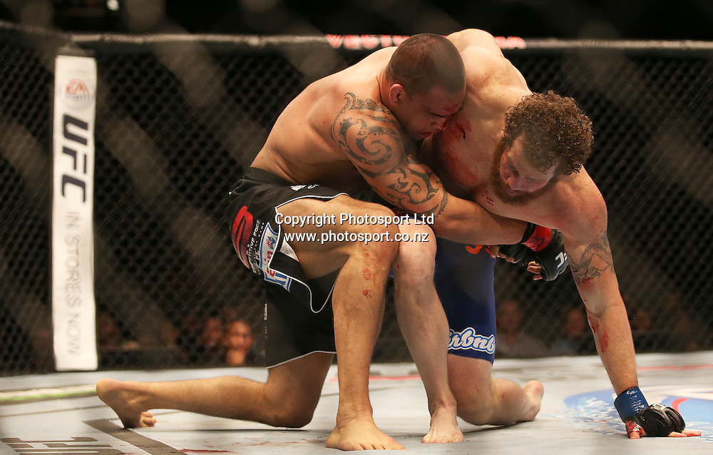 James Te Huna loses the main event to Nate Marquardt during the UFC Ultimate Fighting Championship fight night held at Vector Arena in Auckland on Saturday 28th of July 2014. <br /> Credit; Peter Meecham/ www.photosport.co.nz