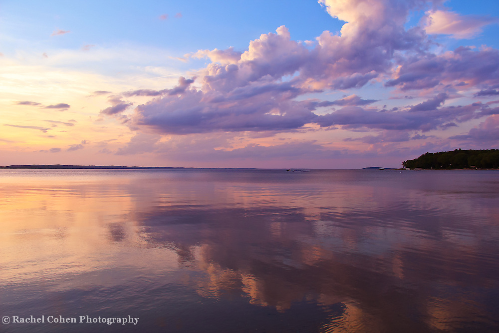 &quot;To the Right of Sunset&quot;<br /> <br /> Billowing clouds mirrored on a lake at sunset!!<br /> <br /> Sunset Images by Rachel Cohen