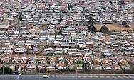 05/07/2010 - 2010 FIFA World Cup - An aerial view of houses and a football pitch in Diepkloof, Soweto, on the outskirts of Johannesburg, alongside the N1 highway - Photo: Simon Stacpoole / Offside.