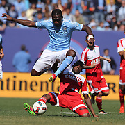 Kwadwo Poku, NYCFC, is challenged by Gershon Koffie, New England Revolution, during the New York City FC Vs New England Revolution, MSL regular season football match at Yankee Stadium, The Bronx, New York,  USA. 26th March 2016. Photo Tim Clayton