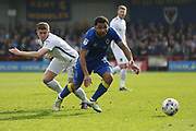AFC Wimbledon striker Andy Barcham (17) and Northampton Town defender Aaron Phillips (18) during the EFL Sky Bet League 1 match between AFC Wimbledon and Northampton Town at the Cherry Red Records Stadium, Kingston, England on 11 March 2017. Photo by Stuart Butcher.