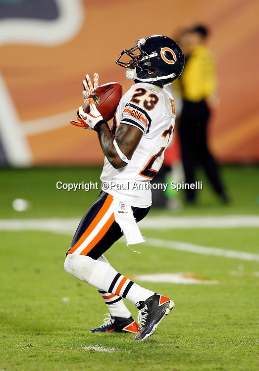 Chicago Bears punt returner Devin Hester (23) catches a punt during the NFL week 11 football game against the Miami Dolphins on Thursday, November 18, 2010 in Miami Gardens, Florida. The Bears won the game 16-0. (©Paul Anthony Spinelli)
