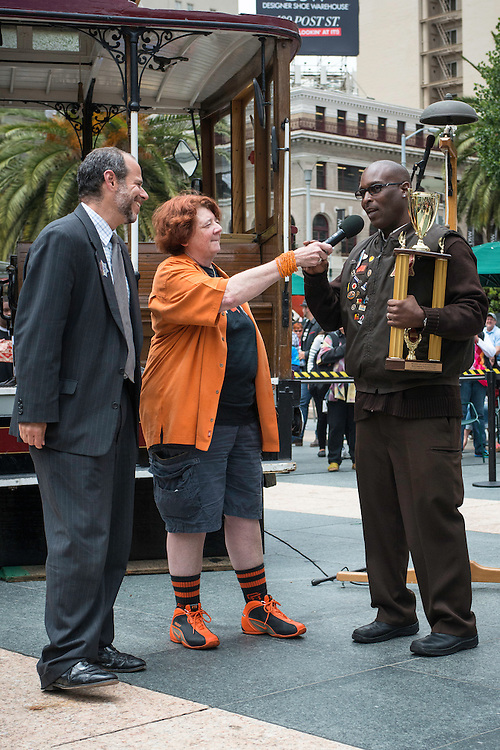 Trini Whittaker says a few words to the crowd after accepting his title and trophy for a second time as World Champion Bell Ringer at the 50th Cable Car Bell Ringing Competition in San Francisco's Union Square | July 11, 2013