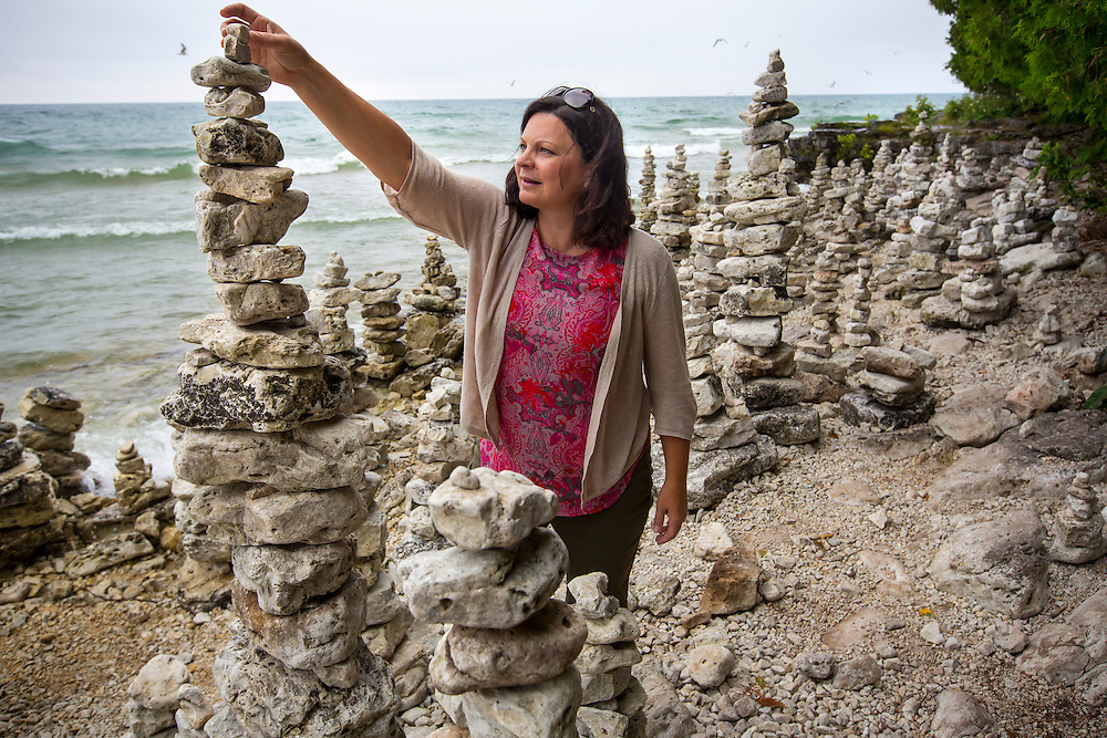 Judy Roemer does some stone stacking at Cave Point County Park in Door County, Wisconsin.  Mike Roemer Photo