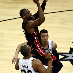 Jun 16, 2013; San Antonio, TX, USA; Miami Heat shooting guard Dwyane Wade (3) shoots against San Antonio Spurs center Boris Diaw (33) during the first quarter of game five in the 2013 NBA Finals at the AT&T Center. Mandatory Credit: Derick E. Hingle-USA TODAY Sports