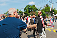 MAY 30, 2011 - Little Neck, New York, U.S. - New York Governor ANDREW CUOMO shakes hands with man along parade route as the Gov. marches in Little Neck-Douglaston Memorial Day Parade, which honors America's veterans, on Northern Boulevard.