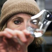Dr Anne Brock check the quality of the latest batch of gin for clarity.<br /> . <br /> Bermondsey Distillery, the makers of Jensen's Gin. Bermondsey Gin is established and owned by Christian Errboe Jensen. <br /> <br /> Bermondsey Distillery, kendt for deres Jensen's Gin, startet og ejet af danskeren  Christian Jensen.  Dr. Anne Brock checker qualiteten på hver eneste destillering inden den sendes videre for at komme på flaske.