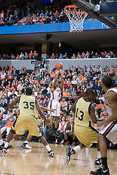 Virginia Cavaliers guard J.R. Reynolds (2) shoots a three pointer against GT.  The Virginia Cavaliers Men's Basketball Team defeated the Georgia Tech Yellow Jackets 75-69 at the John Paul Jones Arena in Charlottesville, VA on February 24, 2007.