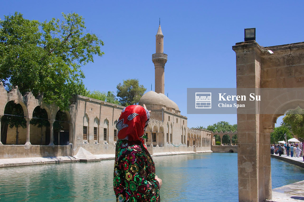 Woman in Halil Rahman Mosque and Pool of Sacred Fish, Sanliurfa, Turkey
