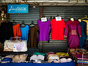 23 FEBRUARY 2018 - BANGKOK, THAILAND: Clothes for sale in front of a shuttered shop in Pratunam Market. Pratunam Market was one of the largest clothing markets in Bangkok. New airconditioned markets, like Platinum and Palladium malls opened nearby, siphoning away customers. Now there are only a handful of merchants left in the market and Bangkok city officials have plans to shut the market and redevelop the land.     PHOTO BY JACK KURTZ