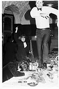 A dining club, Onanist, Oxford Union, Macmillan Room,a man running down a table drunk, March 1981© Copyright Photograph by Dafydd Jones 66 Stockwell Park Rd. London SW9 0DA Tel 020 7733 0108 www.dafjones.com