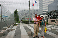 A Chinese family poses for a picture outside of the security perimeter surrouding the National Stadium, also known as the Bird's Nest, outside of the Olympic Green in Beijing , China, Thursday, July, 24, 2008.Very few of the people who come to Beijing leave with a gold medal. Even among those lucky enough to have an Olympic ticket, most come away with the memory of some of those Athletes far away in the distance. Everyone else has to be satisfied with a snapshot of the Bird's nest. (Elizabeth Dalziel)