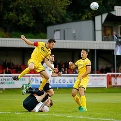 APRIL 1:  Dover Athletic against Bromley in Conference Premier at Crabble Stadium in Dover, England. Bromely's Jack Holland rises above a floored Dover's forward Ryan Bird to clear the ball. (Photo by Matt Bristow/mattbristow.net)