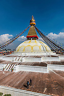 Tourists on the Boudhanath stupa in Kathmandu, Nepal.