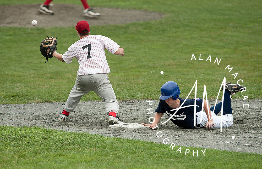 Plymouth's [36-C. Babin] makes it back to the bag ahead of the catch by Farmington's Kevin Poulin during Saturday's game at Plymouth Regional High School.  (Alan MacRae/for the Citizen)