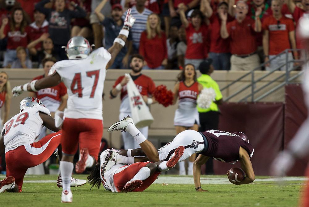 Nicholls State defensive back Darryl Adams Jr. (28) sacks Texas A&M quarterback Kellen Mond (11) during the third quarter of an NCAA college football game Saturday, Sept. 9, 2017, in College Station, Texas. Texas A&M won 24-14. (AP Photo/Sam Craft)