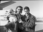 Irish Paralympic Team Arrive Home From Seoul.(R89).1988..28.10.1988..10.28.1988..28th October 1988..The Seoul Summer Paralympics 1988..The very successful Irish Paralympic team arrived home to Dublin today. The team managed a haul of 42 medals, 13 Gold, 11 Silver, 18 Bronze which earned them 19th place in the overall medal table...Tour De France winner Stephen Roche is pictured congratulating Paul Leisk, Cork, on his achievement in winning two bronze medals at the Olympics.