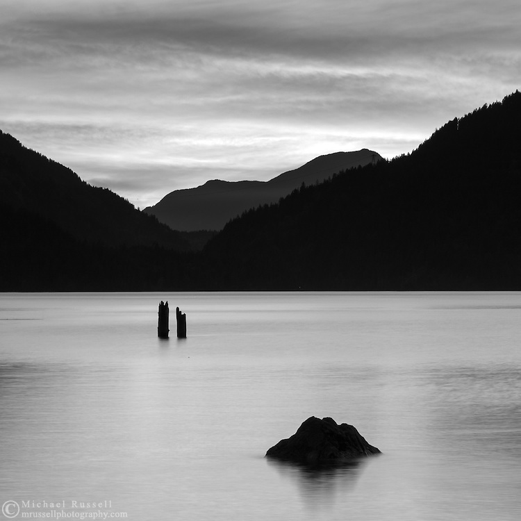 An evening sunset in Black and White at Harrison Lake near Harrison Hot Springs, British Columbia, Canada. The distant mountains are Sasin Peak and Deroche Mountain.