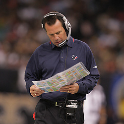 2008 August 16: Houston Texans Head Coach Gary Kubiak looks at his play sheet on the sideline during the first half of a preseason match up against the New Orleans Saints at the Louisiana Superdome in New Orleans, LA. .