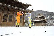 ZHENGZHOU, CHINA -<br /> <br /> Shirtless Monks Practise Kung Fu On Snowy Mountain<br /> <br /> Shirtless martial monks practise Shaolin Kung Fu on the snowy Mount Song in Dengfeng on February 22, 2017 in Zhengzhou, Henan Province of China. <br /> ©Exclusivepix Media