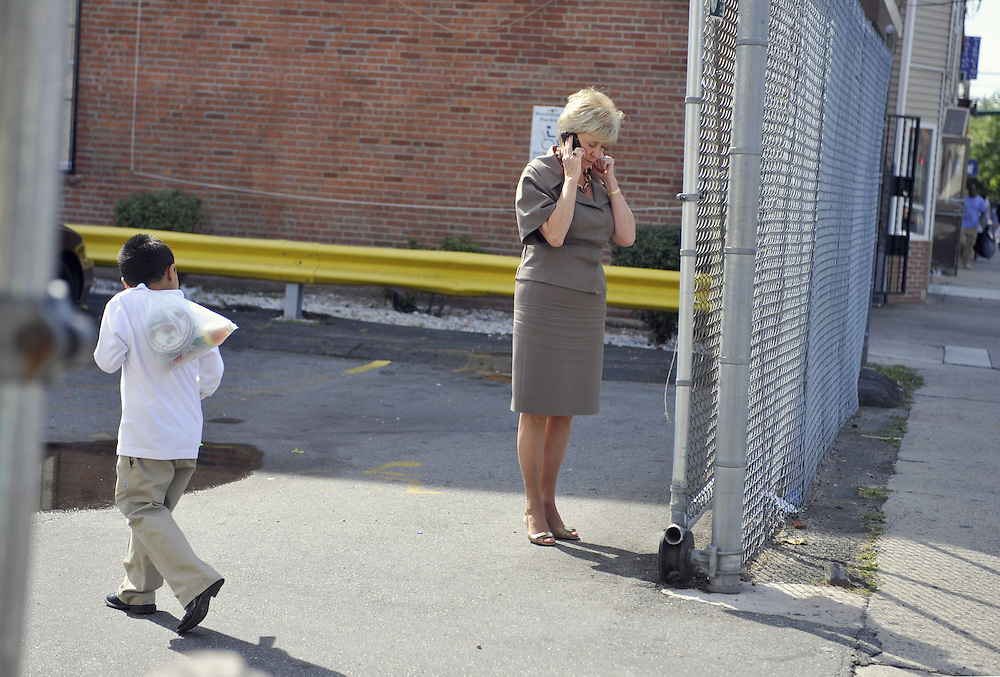 In this Thursday, Sept. 23, 2010 photo, Republican U.S. Senate candidate Linda McMahon takes a phone call in a parking lot in New Haven, Conn. (AP Photo/Jessica Hill)